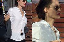 Wyniosła Angelina Jolie eksponuje dekolt w białej koszuli