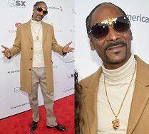 Elegancki Snoop Dogg ukrywa się za okularami ze złotą pszczołą