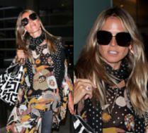 Wypoczęta Heidi Klum zasuwa w japonkach po lotnisku