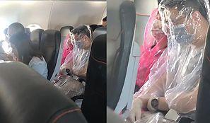 Koronawirus. Spanikowani pasażerowie samolotu owinięci folią