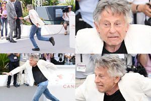 """Roman Polański stroi miny i próbuje robić """"jaskółkę"""" w Cannes (ZDJĘCIA)"""