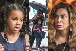 Córka Beyonce z babcią mokną w rzęsistym deszczu (ZDJĘCIA)