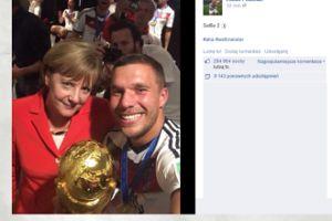 Lukas Podolski i szczęśliwa Angela Merkel