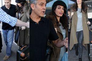 Ciężarna Amal Clooney z mężem na lotnisku (ZDJĘCIA)