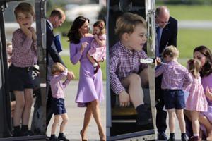 Szczęśliwy książę George siedzi za sterami śmigłowca (ZDJĘCIA)