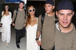 Paris Hilton z chłopakiem w brudnej bluzie spacerują po lotnisku (ZDJĘCIA)