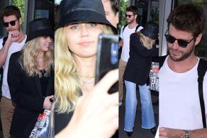 Nieco zmęczona Miley Cyrus i cierpliwy Liam Hemsworth pozują fanom do zdjęć w Warszawie (ZDJĘCIA)