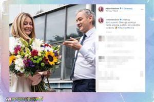 Robert Biedroń i Małgosia Rozenek podziwiają bukiet kwiatów