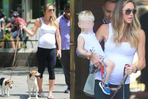 Ciężarna żona syna Donalda Trumpa na spacerze z dzieckiem i dwoma psami (FOTO)