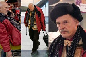 Samotny Korwin-Mikke ciągnie walizkę do tramwaju (ZDJĘCIA)