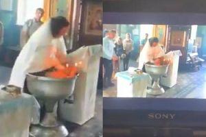 Rosyjski kapłan ZRANIŁ roczne dziecko, siłą wpychając je pod wodę w trakcie chrztu (WIDEO)