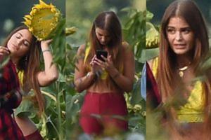 Buszująca w chaszczach Honorata Skarbek robi sobie zdjęcie z dorodnym słonecznikiem (ZDJĘCIE)