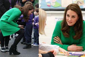 Księżna Kate w zieleni rozczula się na widok uczniów szkoły podstawowej (FOTO)