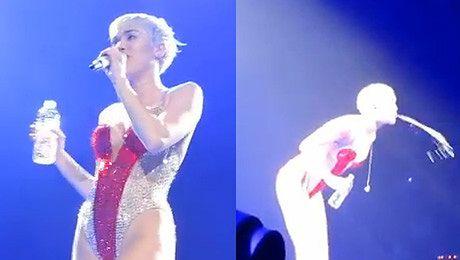 Miley PLUJE wodą na widownię