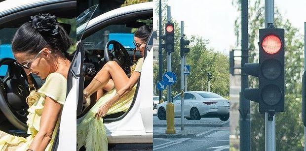 Wystrojona Justyna Steczkowska gra nogą na parkingu i przejeżdza na czerwonym świetle (ZDJĘCIA)