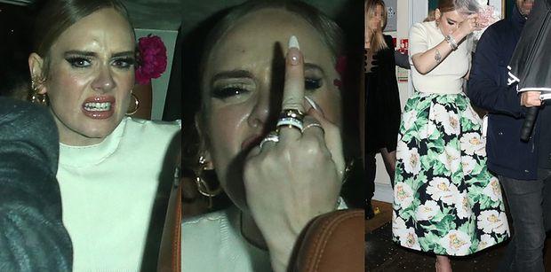 Rozjuszona Adele i jej wydatne usta pozdrawiają paparazzi środkowym palcem (ZDJĘCIA)