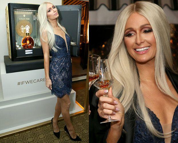 Opalona Paris Hilton pręży się przy butelce koniaku...