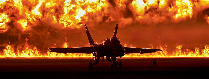 F18 Hornet in front of a wall of fire at the Homecoming Airshow in Pensacola