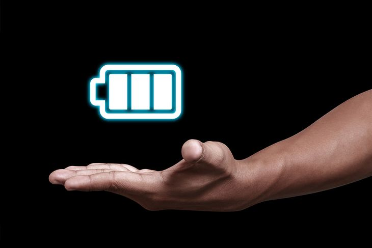 Hand showing a battery icon