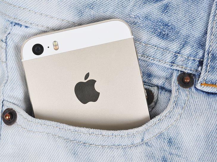 Gold iPhone 5s in a denim pocket