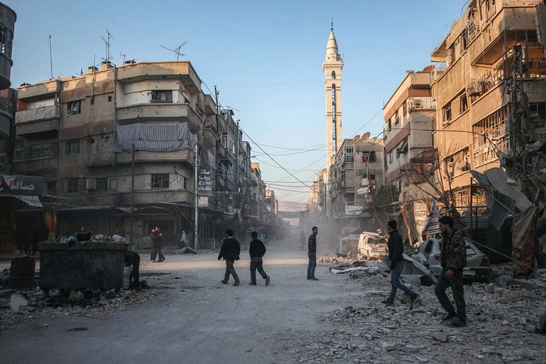 DOUMA, DAMASCUS, SYRIA - 2018/02/07: Buildings seen being damaged by the air strike.The Syrian regime forces carried our air strike in the rebel held town of Douma. 14 anti government rebels has reported dead by this attack. (Photo by Muhmmad Al-Najjar/SOPA Images/LightRocket via Getty Images)