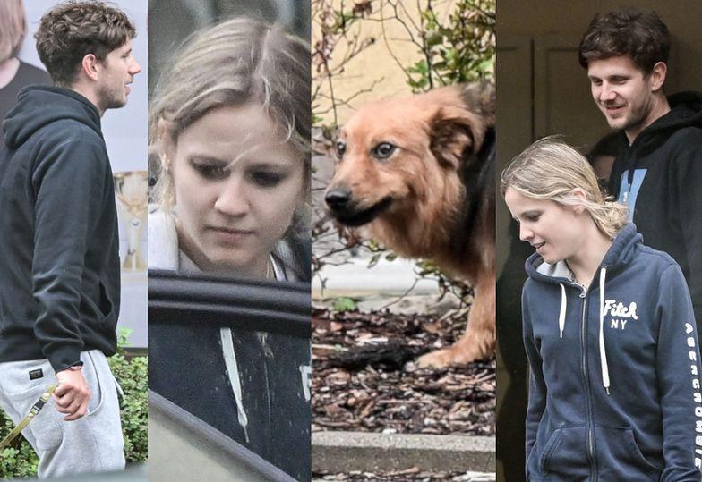 Zaspany Antek Królikowski z dziewczyną odbiera psa od groomera