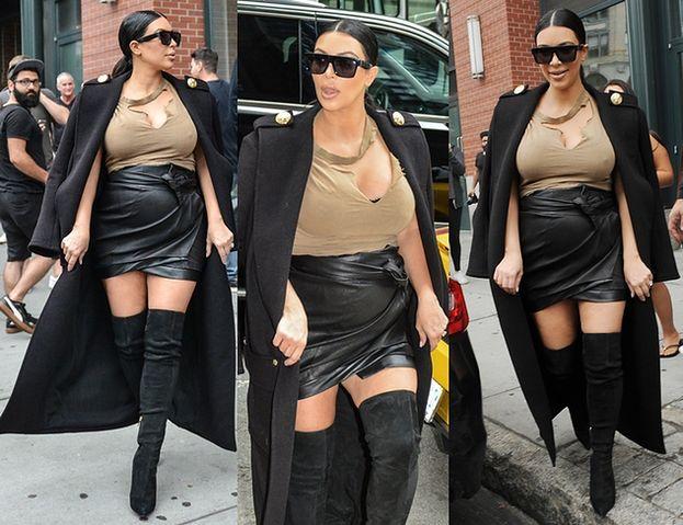 Kim Kardashian w porwanej bluzce... (ZDJĘCIA)