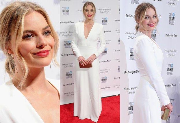 Margot Robbie w białej sukni na czerwonym dywanie