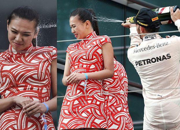 Lewis Hamilton oskarżony o seksizm! OBLAŁ TWARZ HOSTESSY SZAMPANEM! Spójrzcie na jej minę...