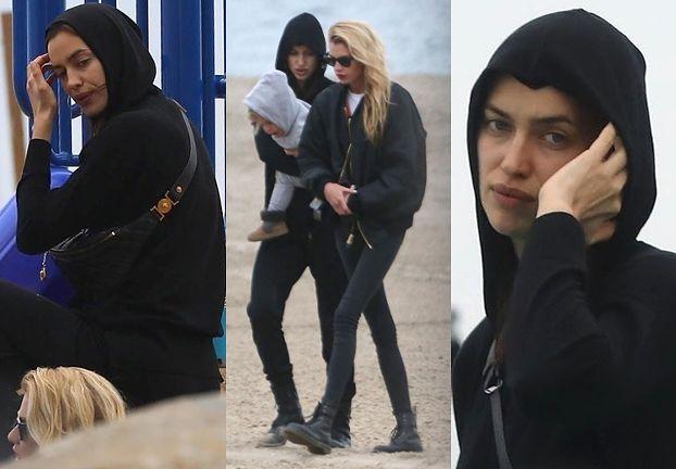 Smutna Irina spaceruje po plaży z dzieckiem w towarzystwie Stelli Maxwell (FOTO)