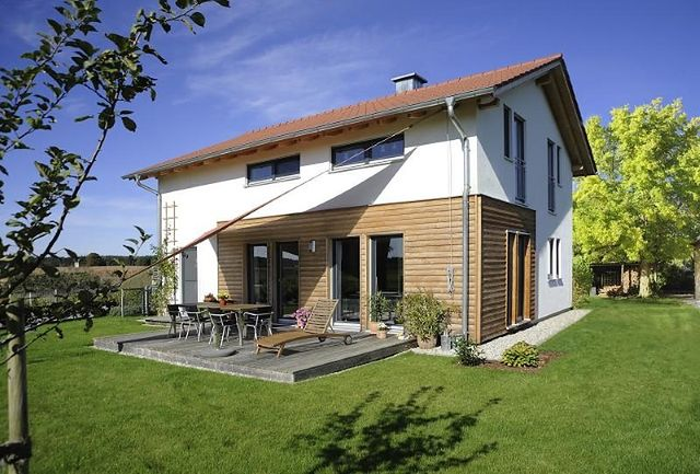 Modernistyczne Domy z drewnem w roli głównej - Drewniana elewacja domu. Ciekawe ZA05