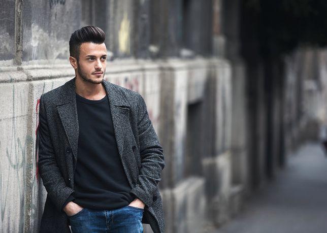 201962d6c272c Portrait of young handsome stylish man in elegant coat. Outdoor fashion  portrait.