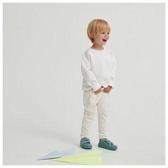 Reserved - Bawełniane spodnie dresowe z naszywką - Kremowy