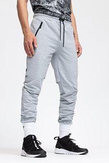 Spodnie dresowe męskie SPMD200 - chłodny jasny szary melanż