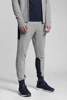 Spodnie dresowe męskie Kamil Stoch Collection SPMD501 - szary melanż